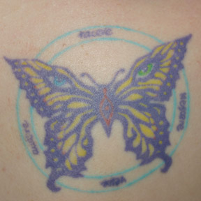 My butterfly has Delirium\'s mismatched eyes and the Latin Witches\' Pyramid mantra around it.